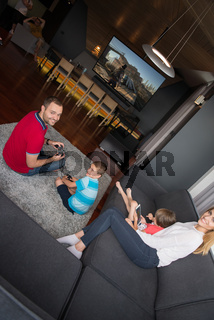 Happy family playing a third-person video game