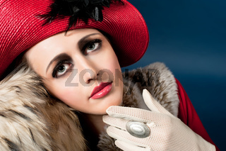 Retro style portrait of a young woman in red hat