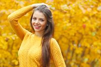 Young brunette in autumn park