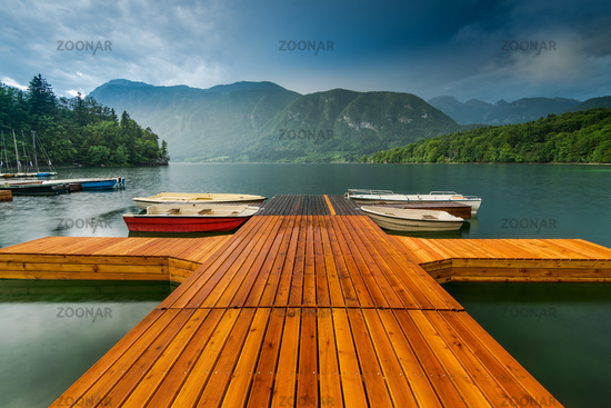 Colorful and artistic wooden pier at Bohinj Lake, Slovenia