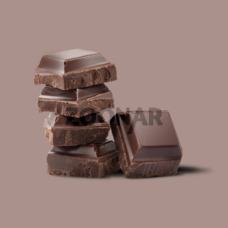 pieces of chocolate on a brown background