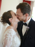 The bride and the bridegroom kissed after the wedding ceremony in the town hall