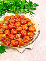 Tomatoes baked in pan on table