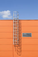 Modern industrial building wall with metal ladder