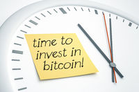 clock with sticky note time to invest in bitcoin