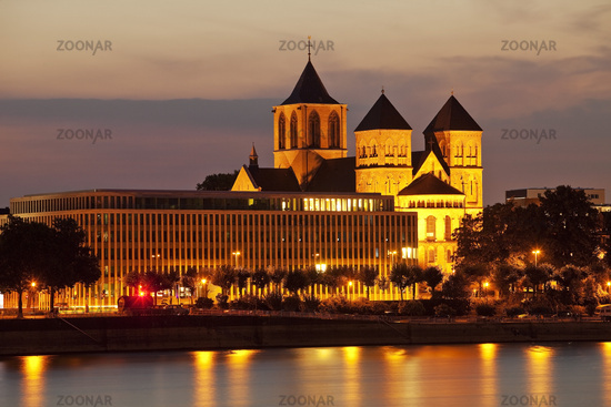 cityscape Cologne with church St. Kunibert and the Rhine in evening red, Cologne, Germany