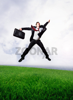 Jumping business man on Green Field