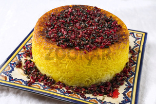 Traditional Iranian Rice Pie Tahdig Polo with Berberis as close-up on a plate