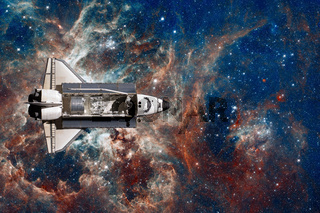 Space Shuttle flight over space nebula.