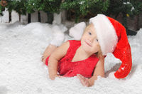 smiling girl in santa costume on snow