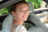 Bride in bridal car looking into the camera