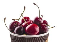 Bowl of fresh red cherries on white background