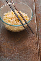 Soup Ramen noodles in glass bowl and wooden sticks