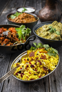 Traditional Indian Iranian Curries with Tahdig as close-up in a Korai