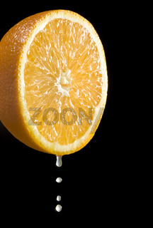 isolated rich citrus fruit orange with fresh juice drops on black background