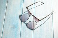 stylish sunglasses on table