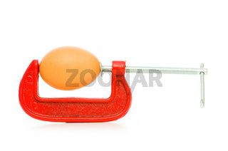 Strength concept with egg and clamp on white