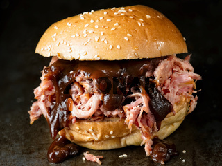 rustic american barbecued pulled pork sandwich