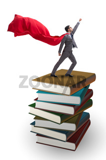 Superhero businessman  in education concept with books