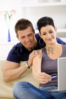Couple browsing internet at home