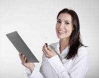 businesswoman with lipstick using digital tablet
