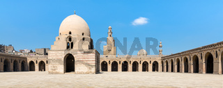 Courtyard of Ibn Tulun Mosque, Cairo, Egypt. View showing the ablution fountain, minaret and minarets of adjoining mosques