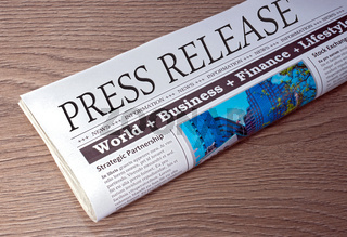 Press Release - Newspaper on desk in the Office