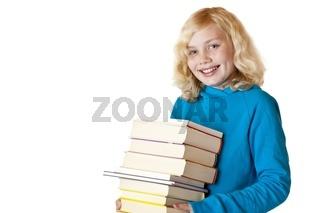 Glückliches Schulmädchen hält Schulbücher in Händen und lacht