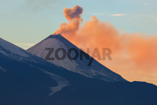 Emission ash from a volcano Klyuchevskoy dawn rays of sun.