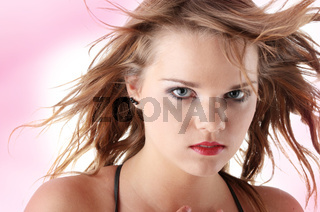 Young teen woman with wind in her hair