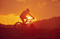 Sunrise with cyclists backlight