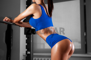 Back view of brunette sexy fitness girl