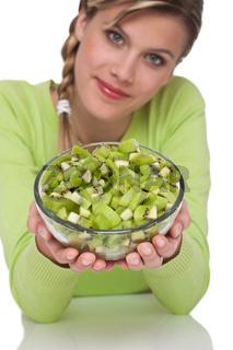 Healthy lifestyle series - Woman holding bowl of kiwi