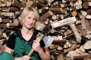 Frau im Holzlager / woman at the wood yard