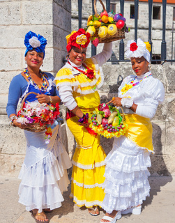 women in traditional Cuban clothes