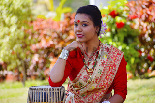 Assamese girl In traditional attire posing with A Dhol Drum , Pune, Maharashtra