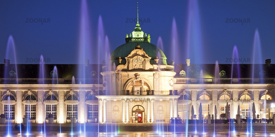 illuminated Kaiserpalais with water columns in the spa park at blue hour, Bad Oeynhausen, Germany