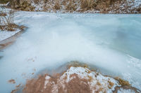 frozen brook in the mountains
