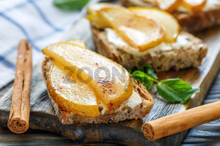 Homemade bread with ricotta and caramelized pears.