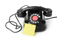 Vintage telephone and blank paper
