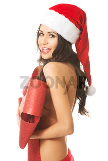 Side view of woman covering her body by ribbon, looking like a gift