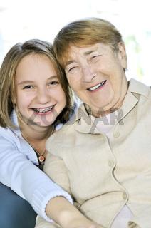 Granddaughter hugging grandmother