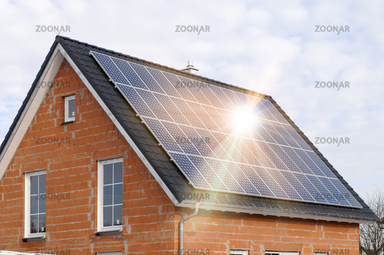 solar panels on residential roof with sun beams