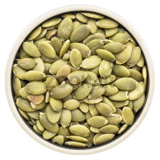 pumpkin seeds in a round bowl