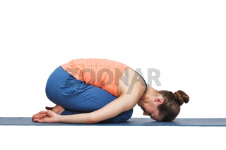 Beautiful sporty fit yogi girl practices yoga asana balasana