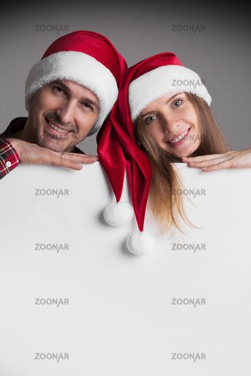 Couple in Santa's hats