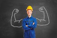 Mann als Bauarbeiter mit Muskeln aus Kreide