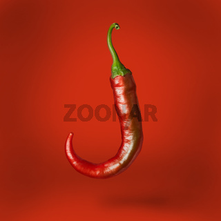 Hot chilli pepper floating over