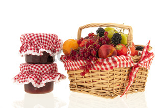 Wicker basket with mixed summer fruit