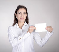 businesswoman presenting white business card